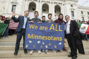 SEnator Hawj stands with constituents at the Capitol during the Day Without Immigrants Rally.