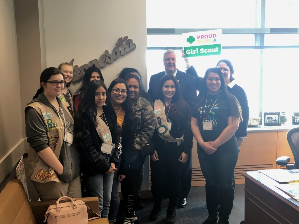 Senator Greg Clausen (DFL-Apple Valley) is pictured with Girl Scouts from ISD 196 on Feb. 26.