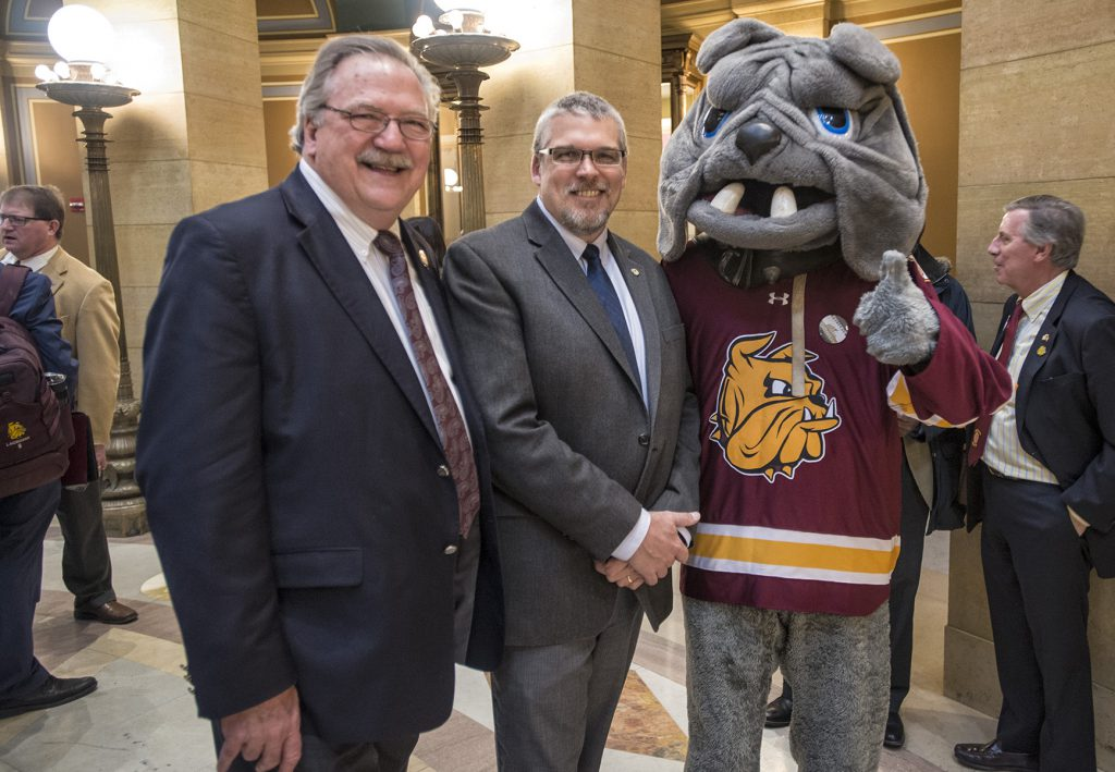Sen. Erik Simonson stands with Champ, the UMD mascot, during Bulldog Days