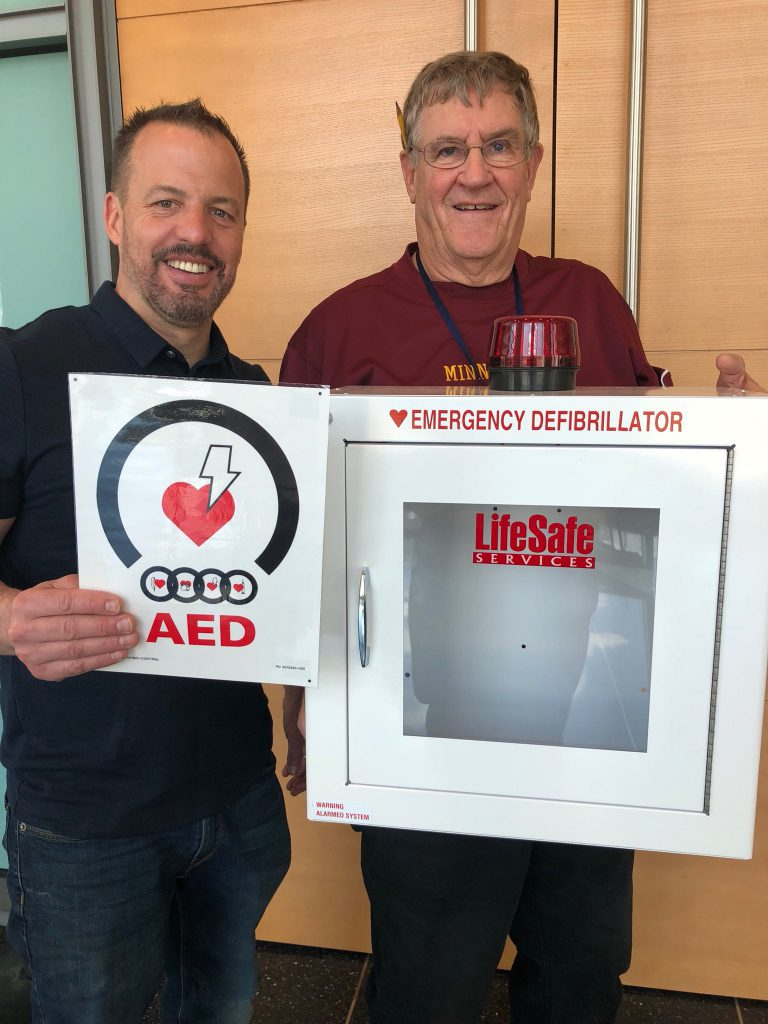 Senator Matt Klein and Mayor Tourville install AEDs